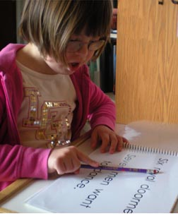 girl with Down syndrom reading