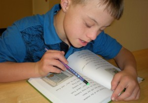Shawn reading one of his Frog & Toad books