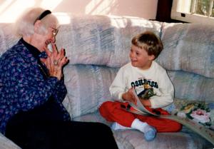 Jonathan, 5, reads a homemade book to Grandma