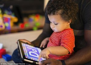 black toddler w: Dad on iPad